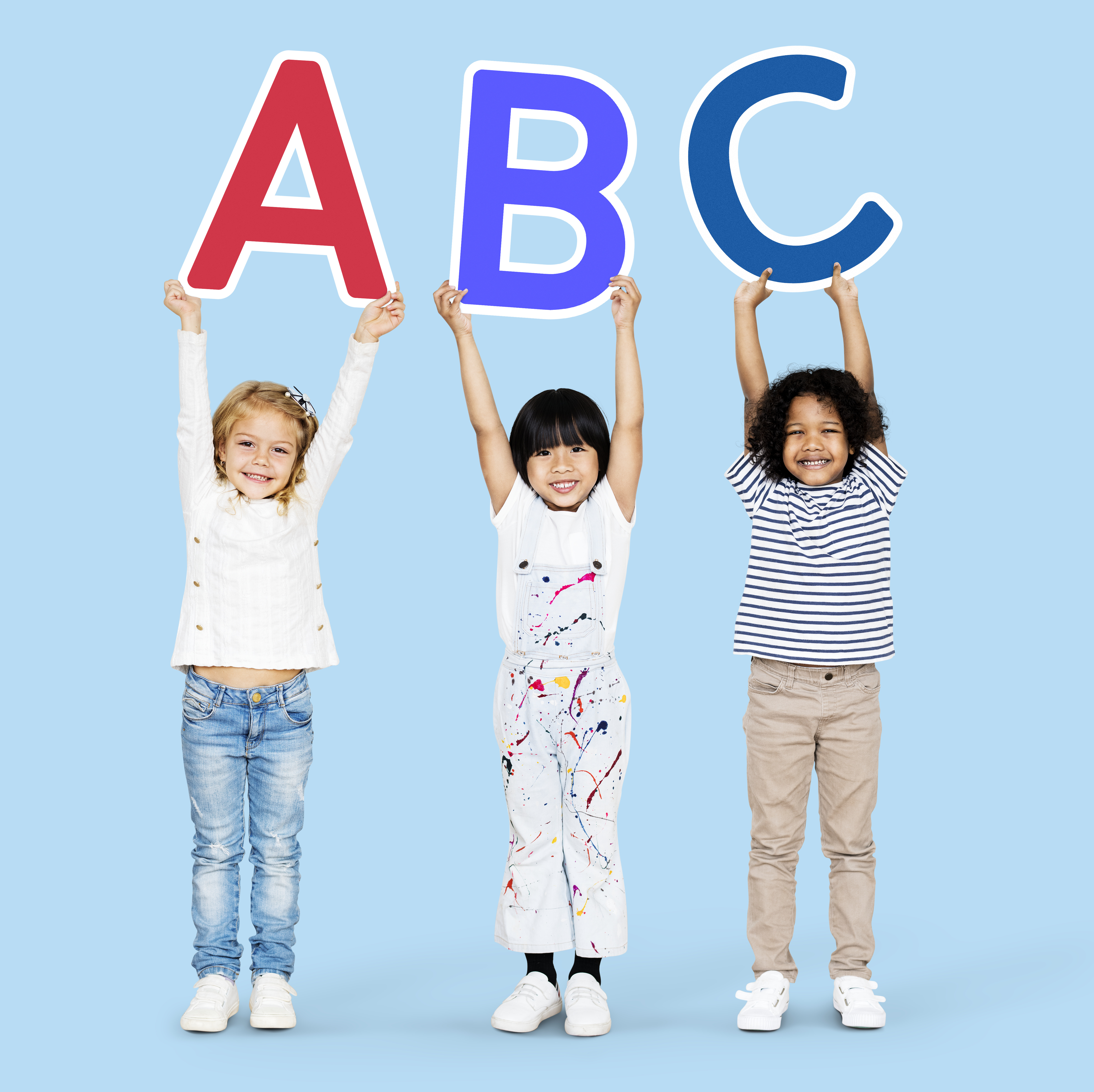 Diverse happy kids learning the ABC